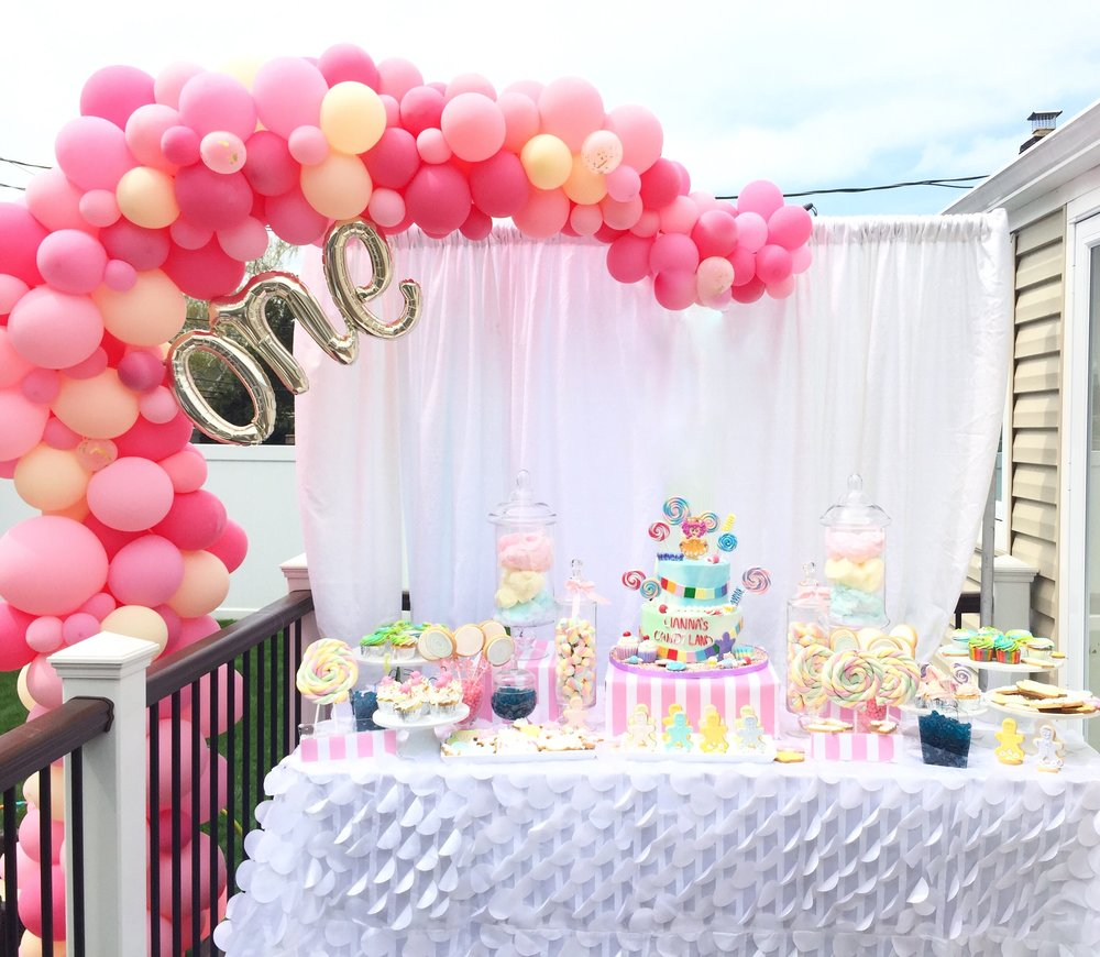LLG Events custom candy table with balloon arch by: Balloons by Amanda