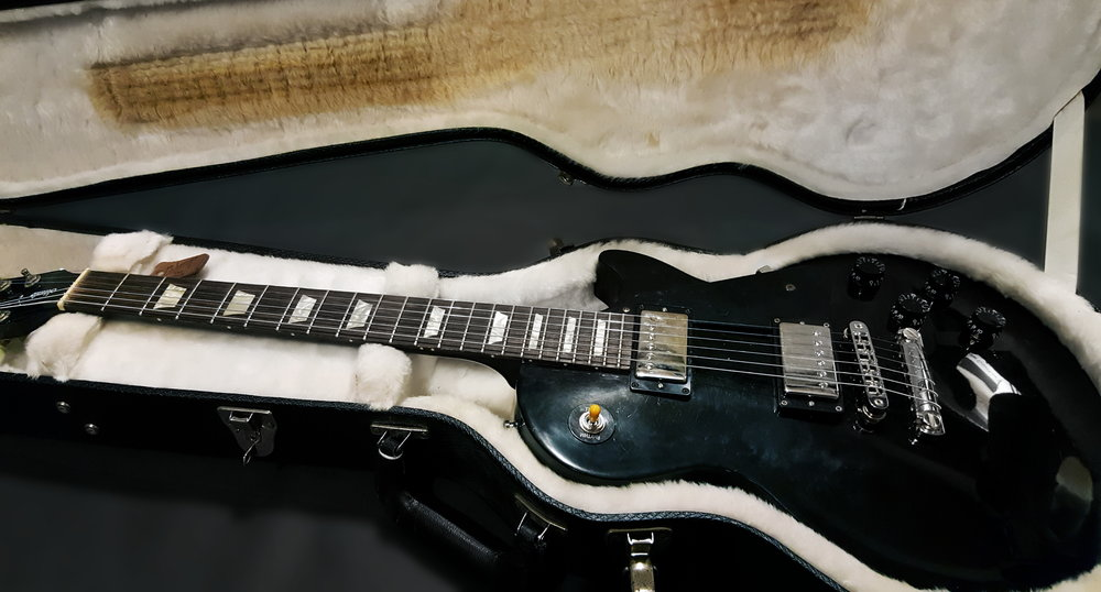 we sent our techs out locally to find a les paul that is both a good accent  to our new black dog harness and that can handle getting a little beat up