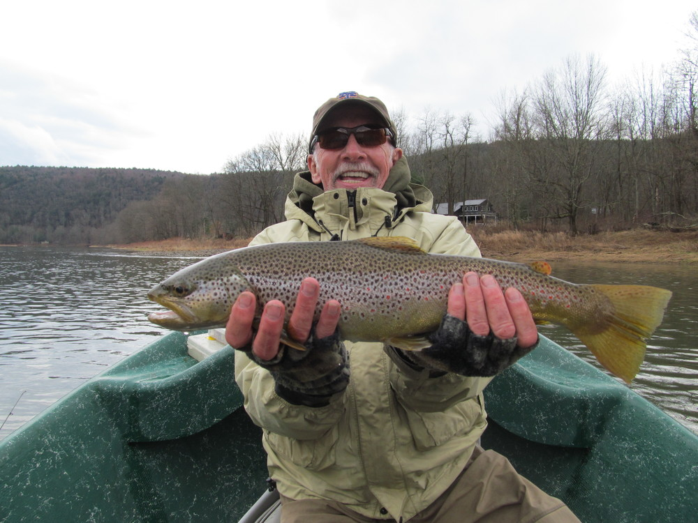 "Pete L. with a beautiful 21"" Brown trout!"