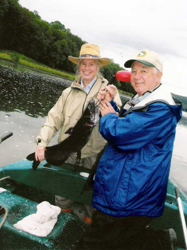 "John P. and wife Nancy with a 29"" Channel Catfish."
