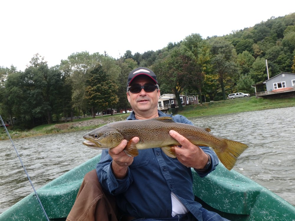 "Tony D. with a beautiful 21"" brown from the west branch."