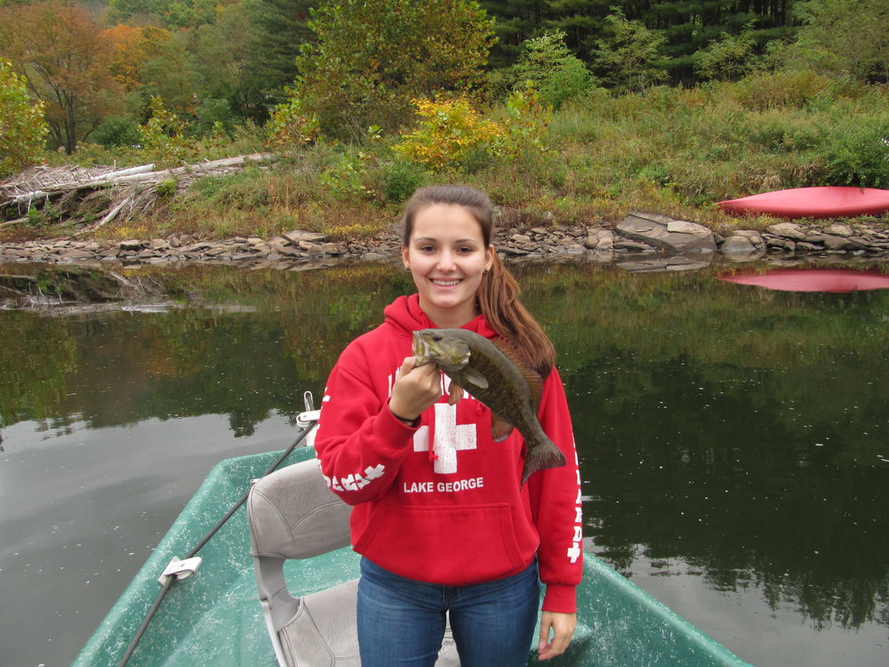 Claire of the Eldred Fishing Club with a Smallmouth Bass.