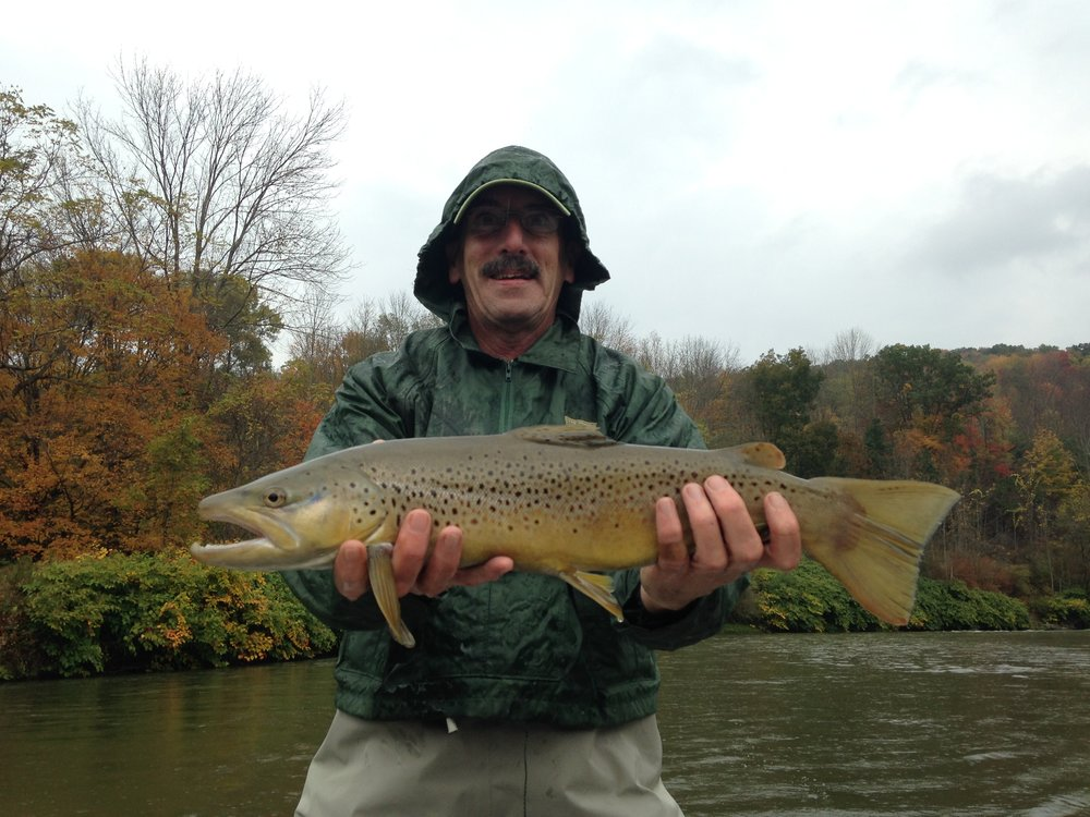 "George W. with a 23"" mean looking Brown trout."