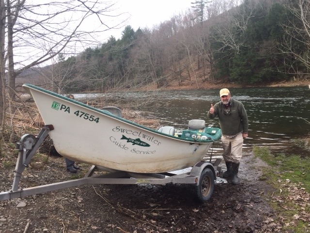 Guide Mike P. launching the boat into the West Branch.