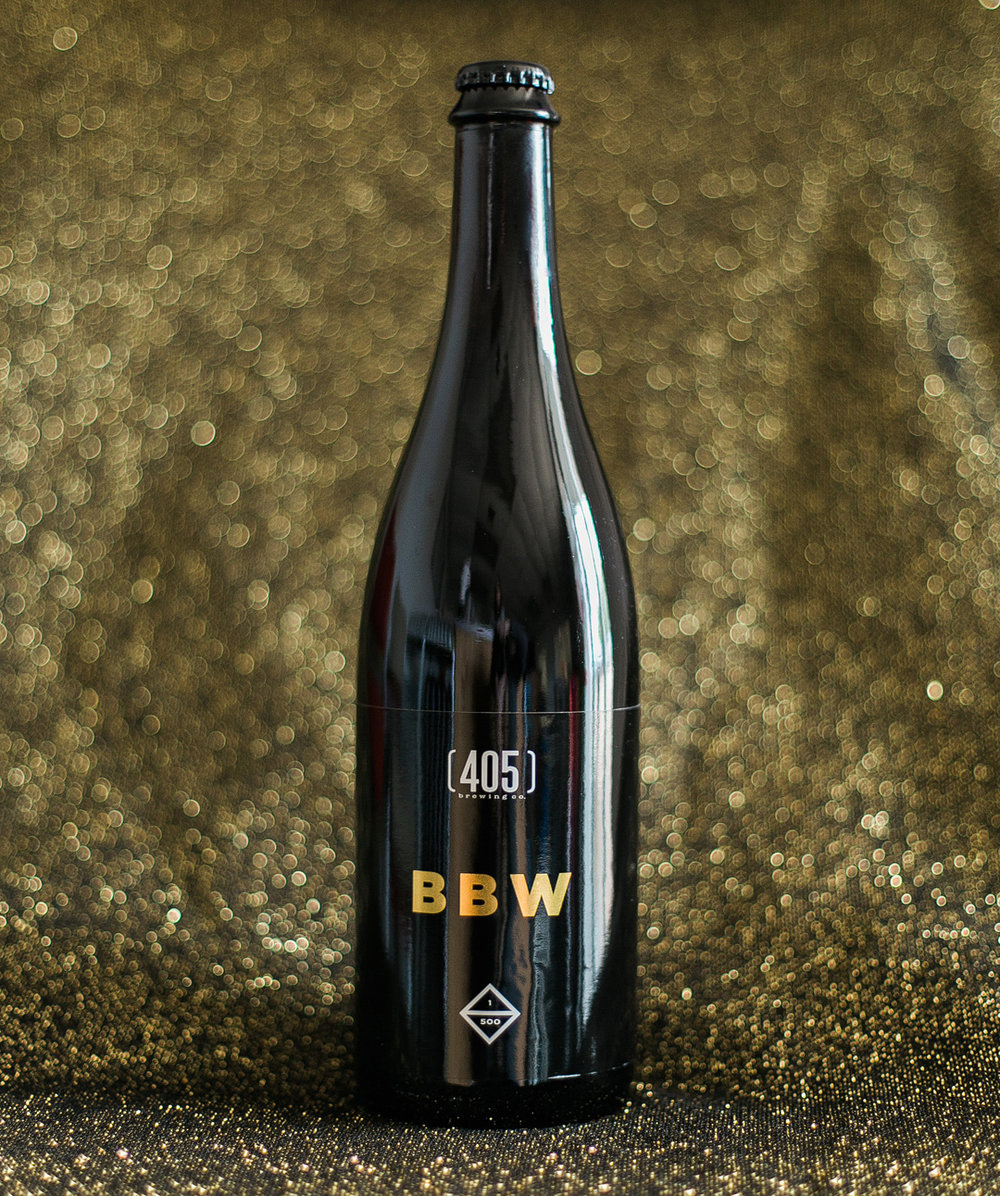 BBW - Barleywine 83% aged in bourbon barrels, 17% aged in bourbon barrels with peaches. Notes of dark fruit and a dry finish. Barrels from Scissortail Distillery (Moore, OK).Style: Bourbon Barleywine ABV: 12%    IBU: