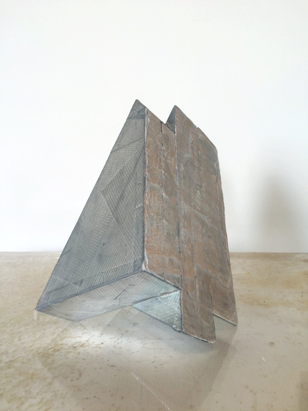 Small prism, 2016  Wood, plaster, duct tape. 12 x 12 x 6