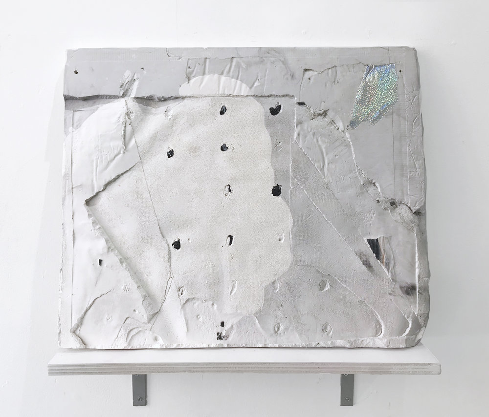 Untitled (Screen relief), 2017  Plaster, paint and paper scraps. 20x24""