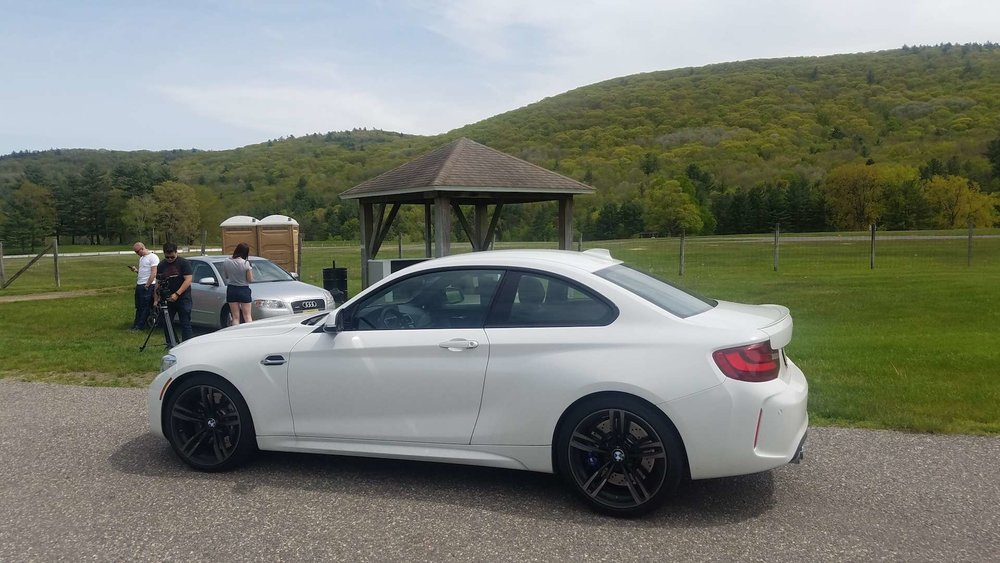 The ever-playful M2 awaits its turn on the Slip 'N Slide skidpad at Lime Rock