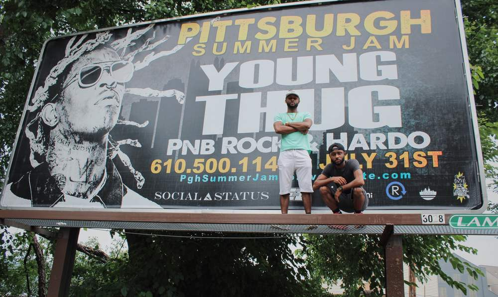 The Hill Brothers at their Summer Jam billboard in the Hill District