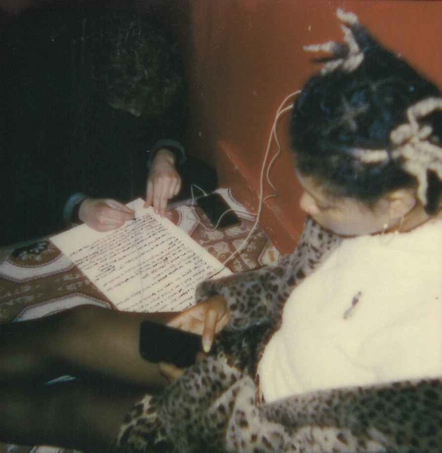 Rob Stokes writing lyrics prior to  '71' s set and Opaline DC founder,  Briona Butler  (foreground). Polaroids by Maxwell Young