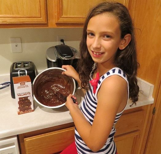 kid baking cherryvale brownies.jpg