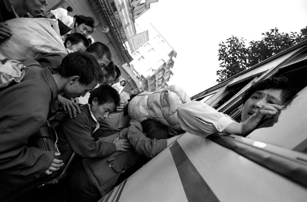 Canton Station Migrant Workers Crowd Bus Hi Res.jpg
