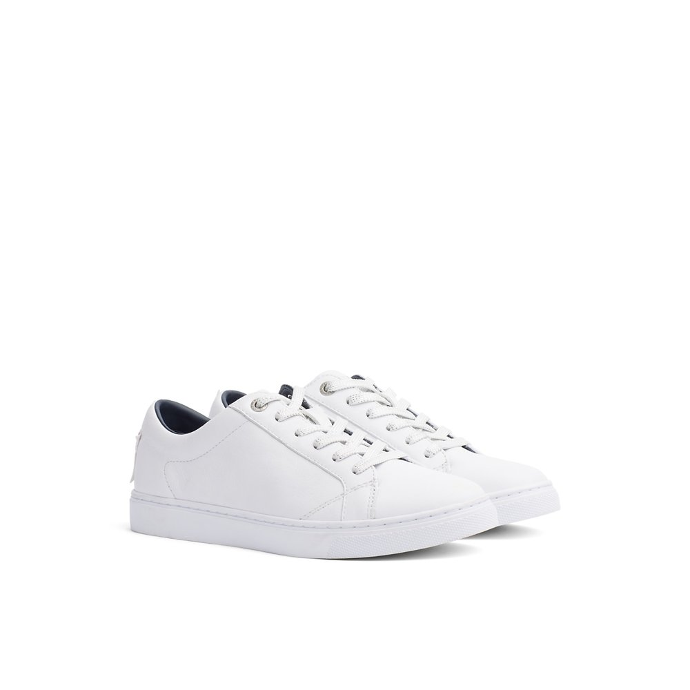 spotted maxi - plain TH sneakers.jpg