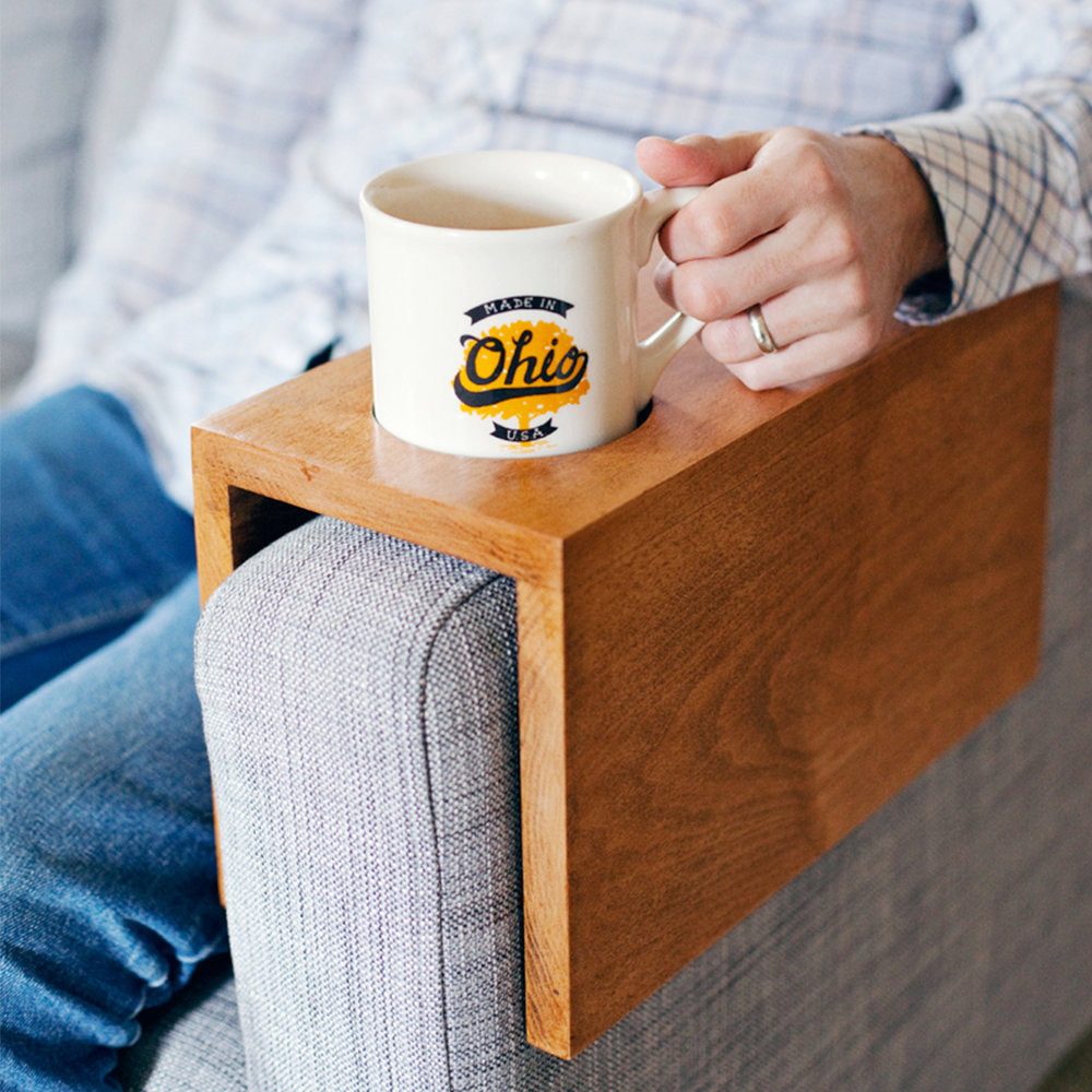 + A wooden sofa sleeve with a cup holder - This is a gift ideal for elders who love their armchair as much as hosting family holidays or reading the grandkids a grandiose story. DIY it (above) or buy it.(Image | A Beautiful Mess)