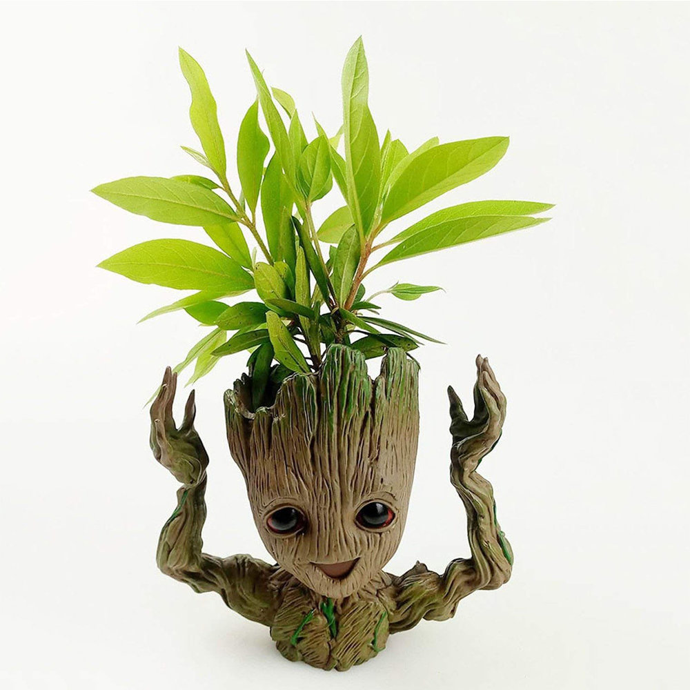 + A groot planter - I am not quite sure what this thing is and I find it incredibly creepy, but I know most find it adorable and any Guardians of the Galaxy fans will love it. If you're not feeling a planter, why not try this necklace or poster?(Image via ClassyGiftsandGlass on Etsy)