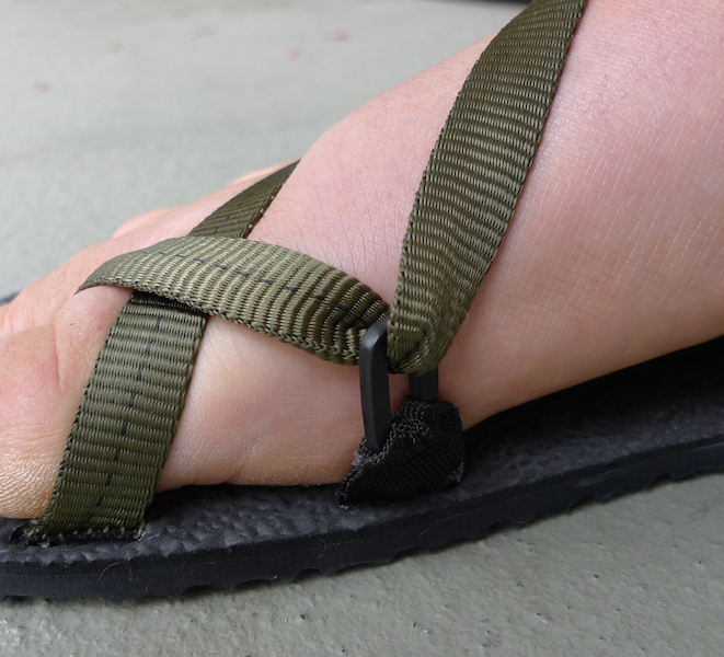 The little plastic loop has rotated 90 degrees so that the webbing doesn't run quite as smoothly. This didn't affect the comfort or function of the sandals, though.