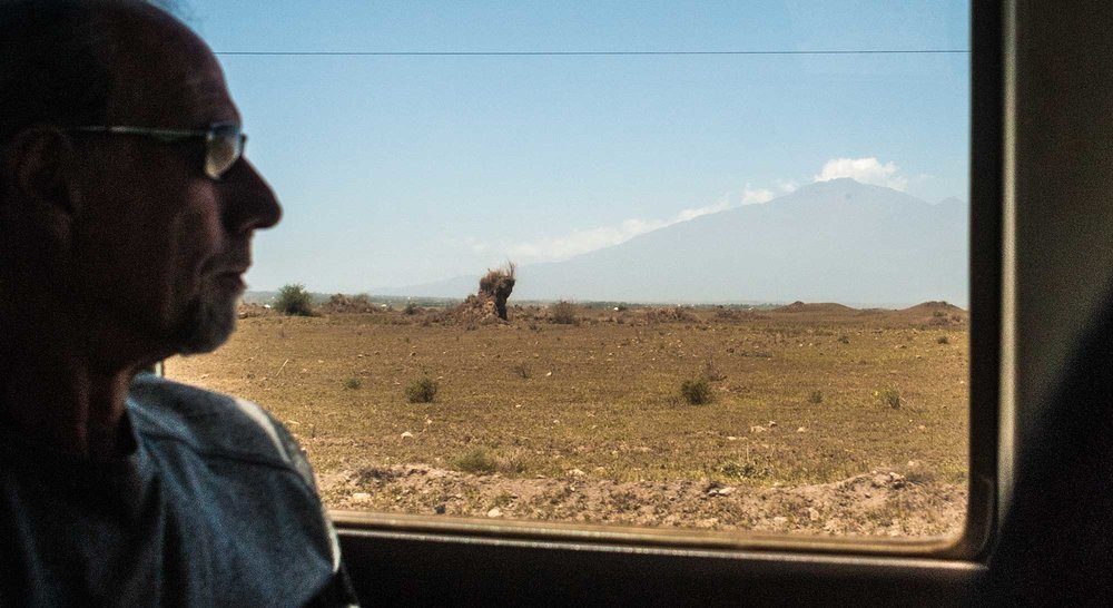My soon to be trail-buddy, Jon Dobbs enjoys the view as we bounce and careen of rocks and ruts in the overcrowded bus.