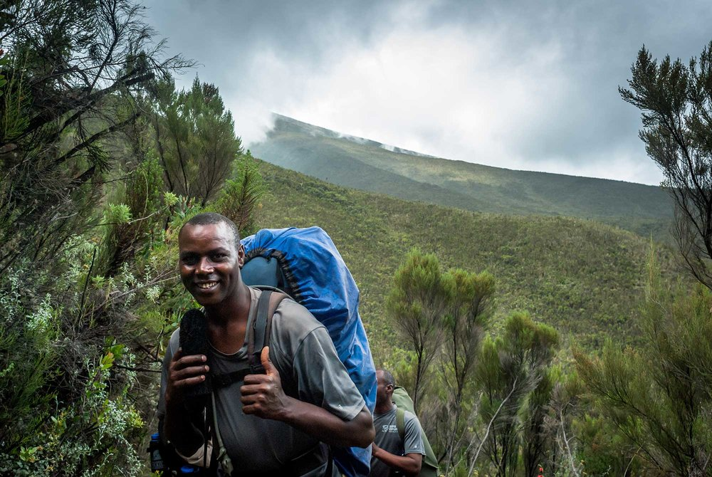 One of our guides, Michael would be celebrating his 50th summit of Kilimanjaro with us.