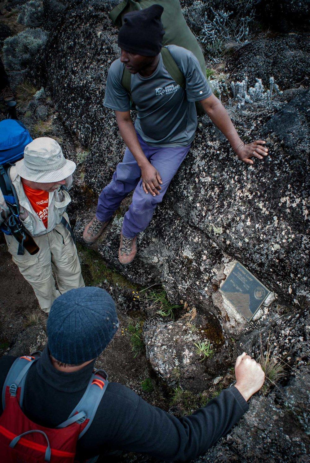 D3-21-Kilimanjaro-guide-teaching-climbers-about-Scott-Fischer-memorial.jpg