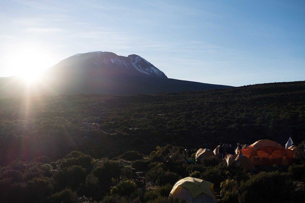 While the team finished packing up, I caught the sun popping up over Kibo and bringing some welcome warmth to our camp.