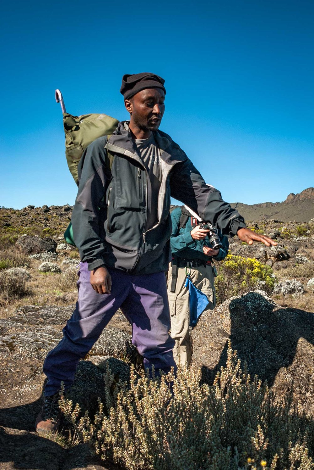D3-16-Kilimanjaro-guide-teaching-about-ecological-zones.jpg