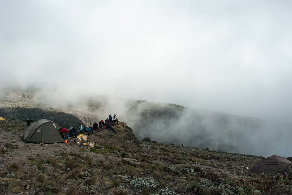 D5-16-porters-listening-to-soccer-on-a-rock-karanga-camp-kilimanjaro.jpg