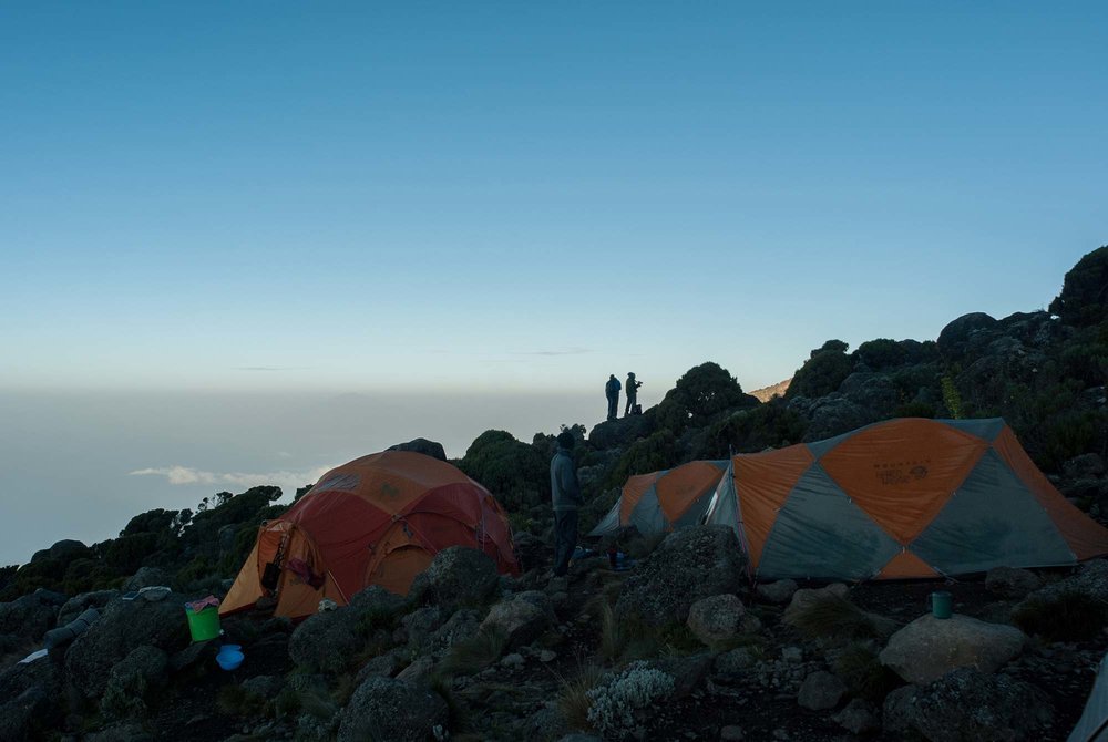 Climbers in Karanga camp getting ready to grab that perfect morning shot of Kilimanjaro's summit cone.