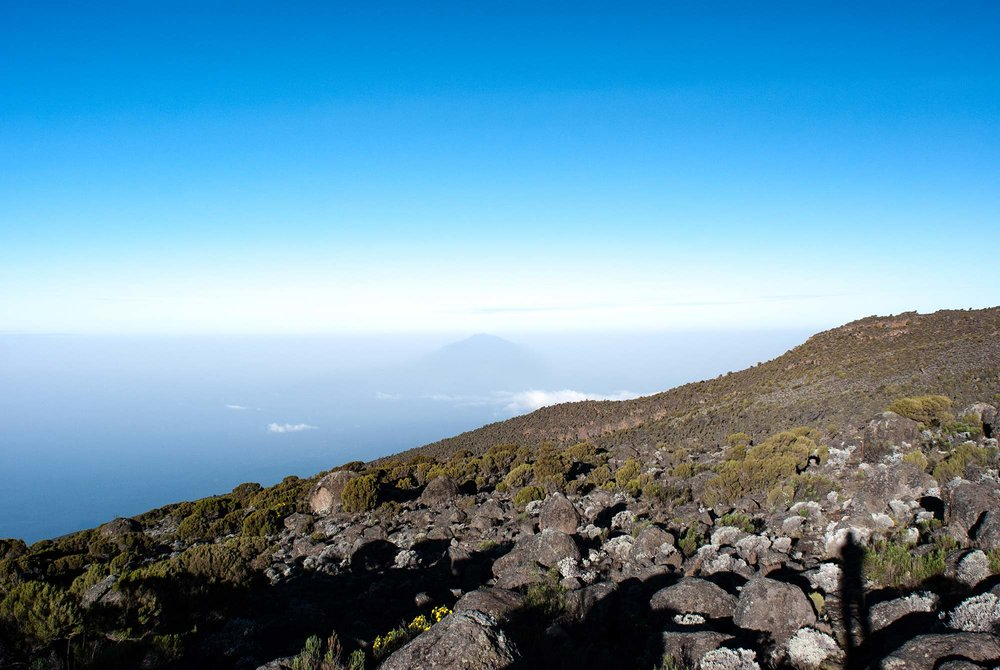 D6-08-meru-pokes-out-of-the-fog-karanga-camp-kilimanjaro.jpg