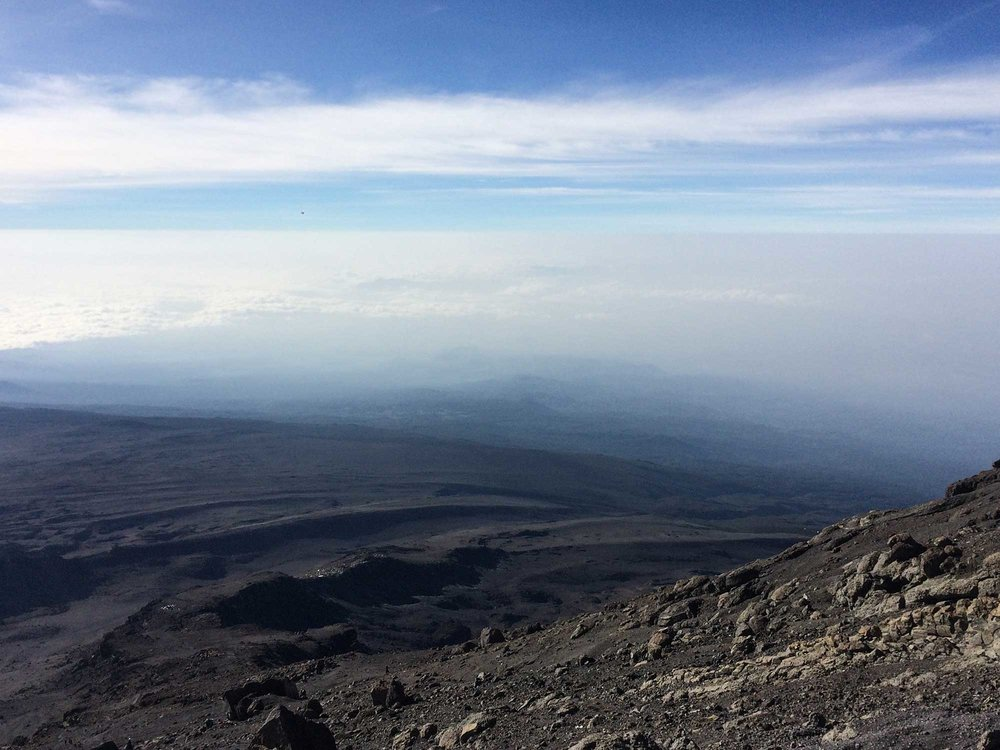 Descending Kilimanjaro: Barufu Camp comes into view thousands of feet beneath us.