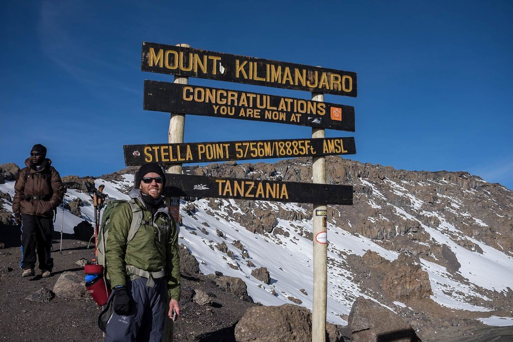 Stella Point on the way down Kilimanjaro. Uhuru Peak is in the background. This is an important milestone for climbers.