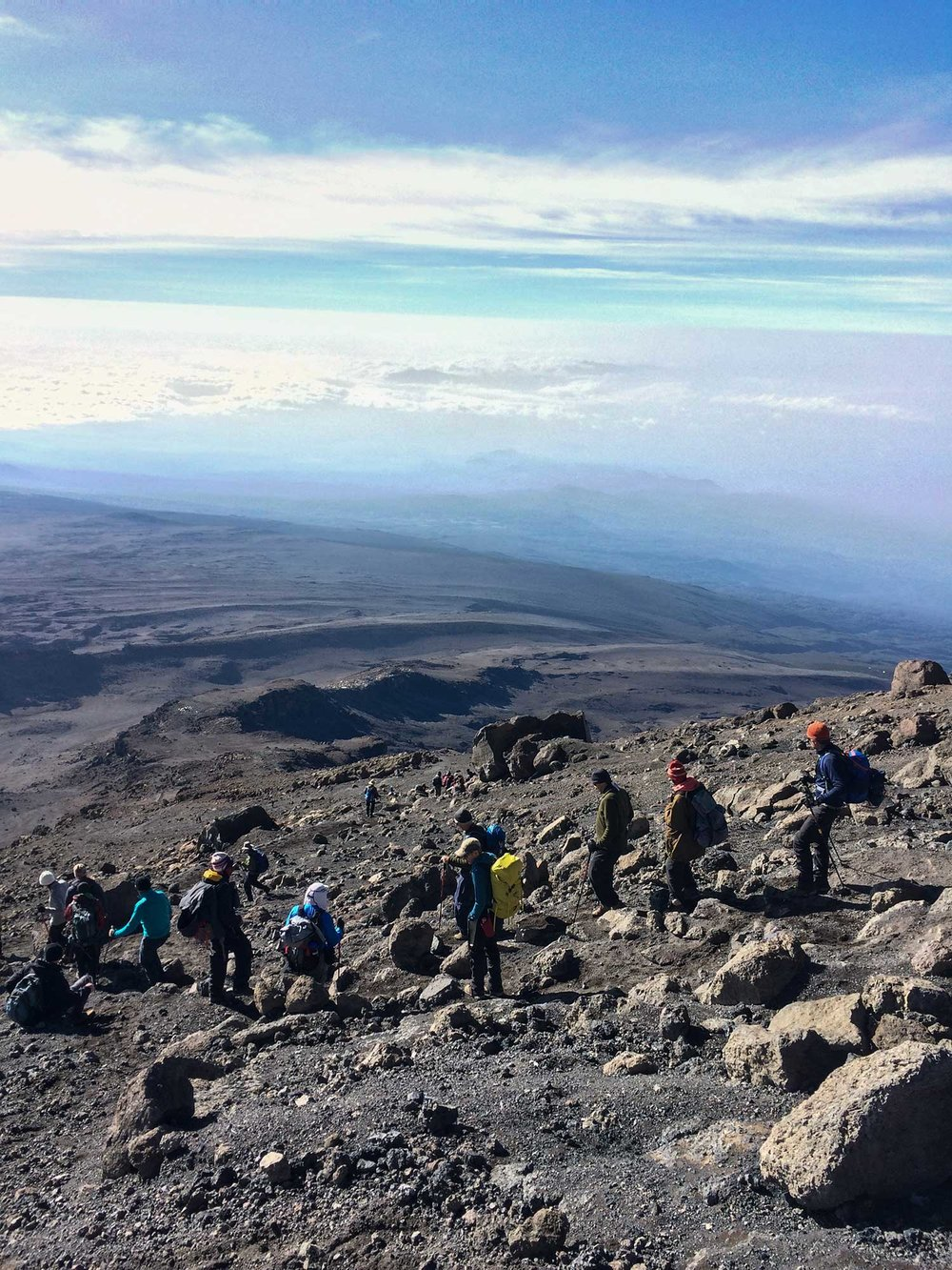 Kilimanjaro climbers descending to Barufu Camp via switchbacks.
