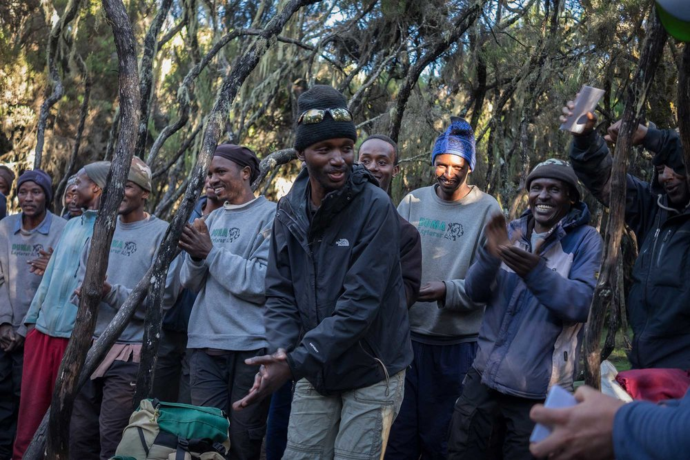 Head guide, Michael leads the entire team in a traditional Swahili song.