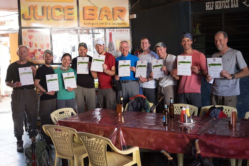 Ten happy Kilimanjaro climbers who all summited and descended safely.