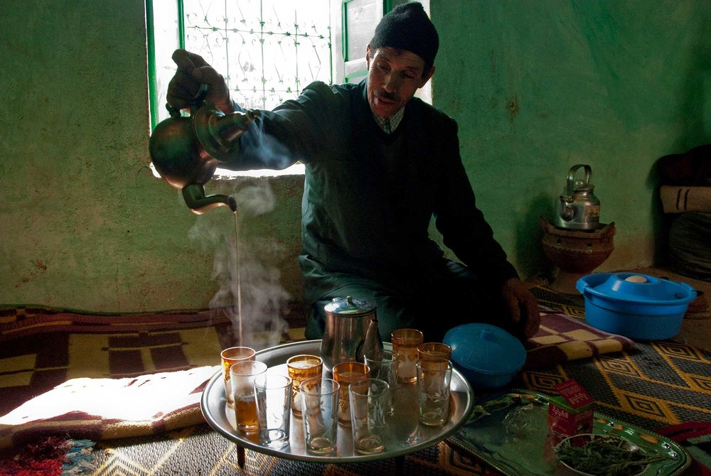 Our host pours mint tea for the group in the traditional way, allowing it to cool with the long pour.