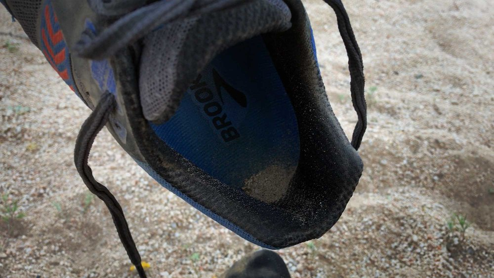 Despite wearing gaiters, the dirt piled up in my shoes while on the PCT, leading to small blisters at the corner of the heel.