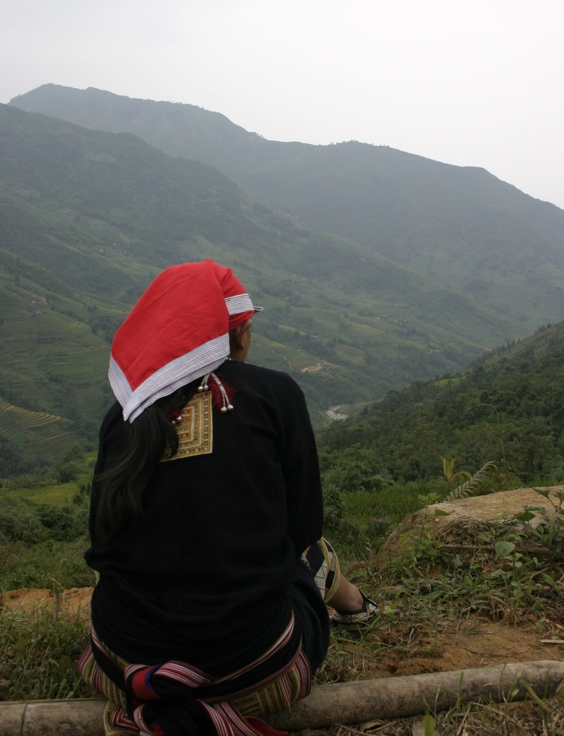 May Lai, Red Dao community member and homestay owner taking in the view towards Trung Trai.