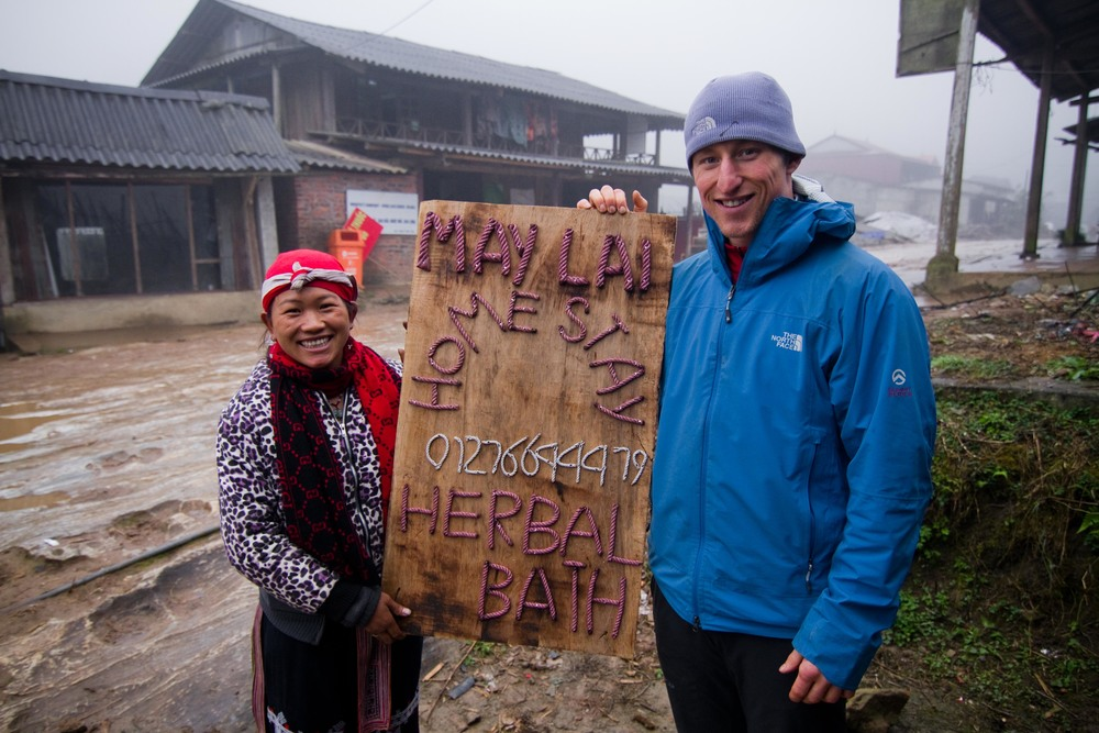 Jase with May Lai and her new sign in Taphin