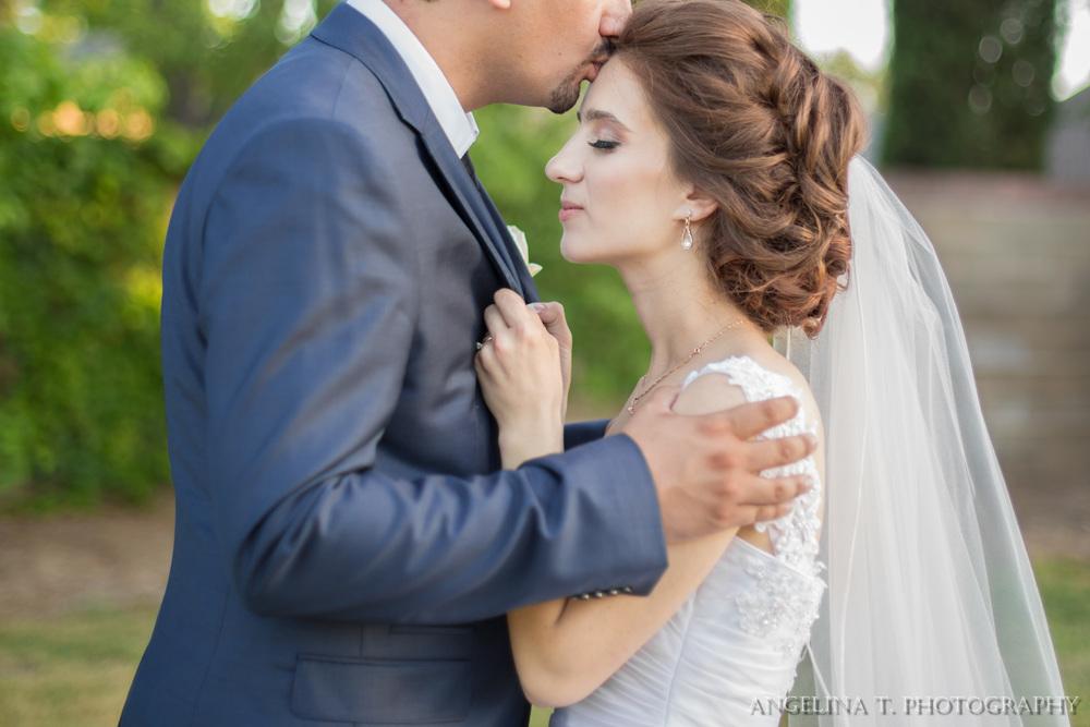 sacramento-wedding-photographer-11-bride-grabbing-grooms-jacket.jpg