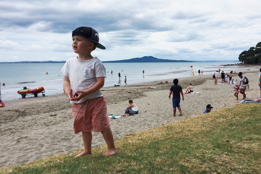 Finn (2) at Mairangi Bay Beach on New Year's Day