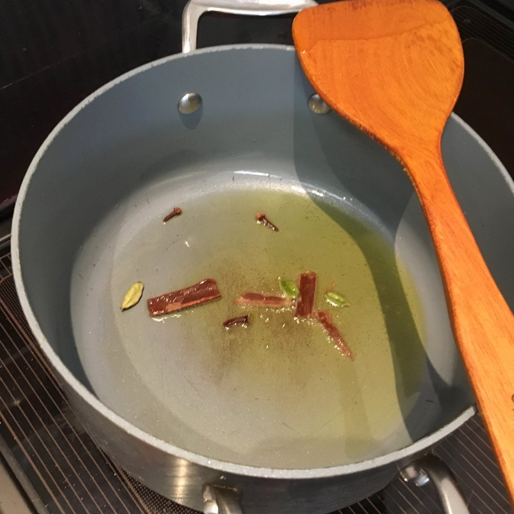 Heat ghee or oil - Fry cinnamon sticks, cardamom pods and cloves to release the scent...