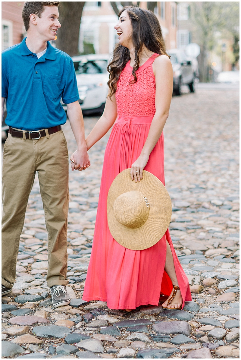 Old Town Alexandria | Spring engagement on cobblestone street with sunhat