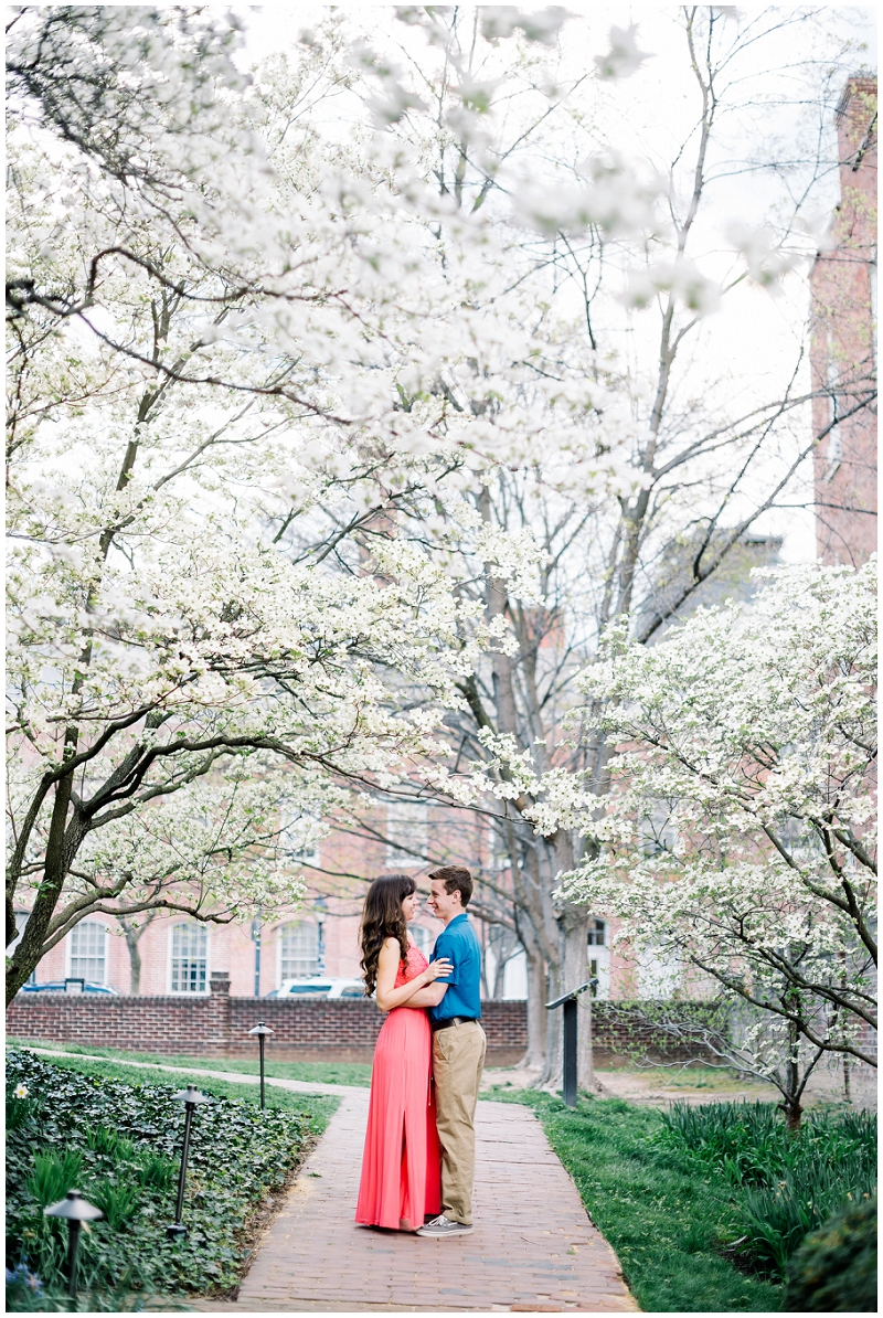 Old Town Alexandria | Spring engagements under dogwood tree | coral maxi dress