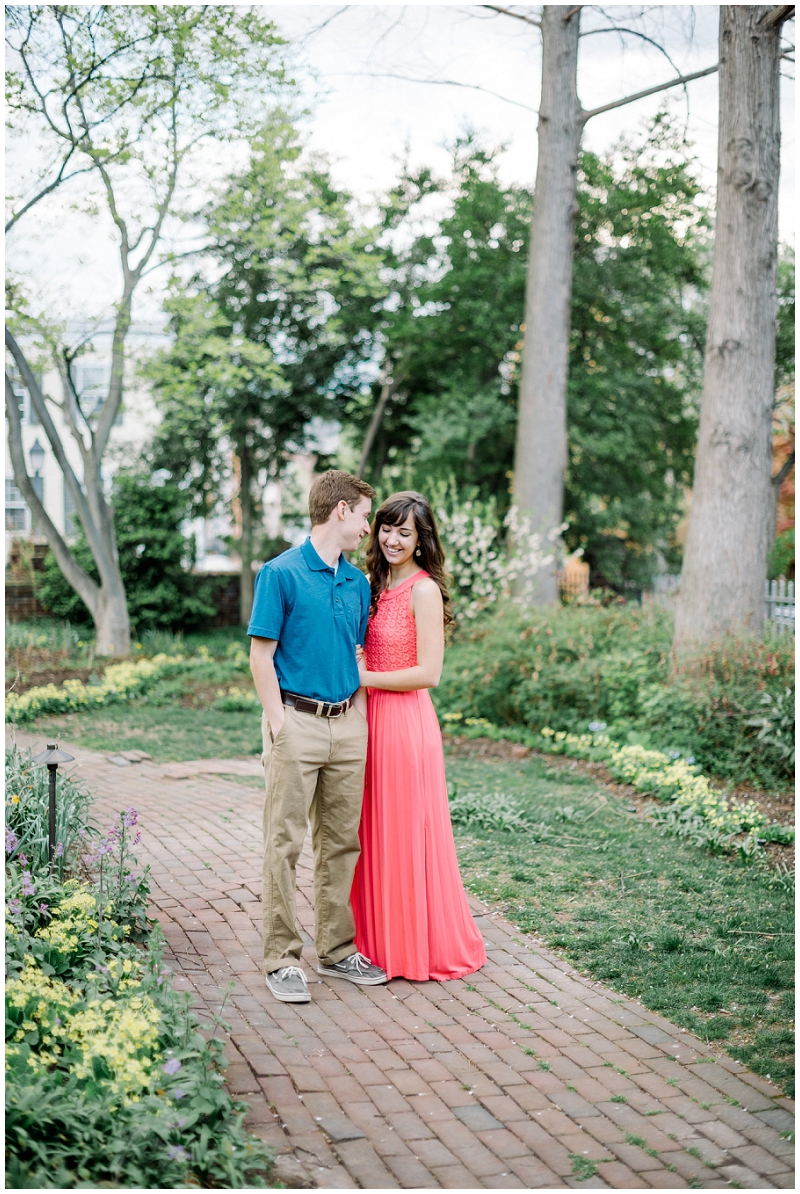 Old Town Alexandria | Spring engagement in historical garden | coral maxi dress
