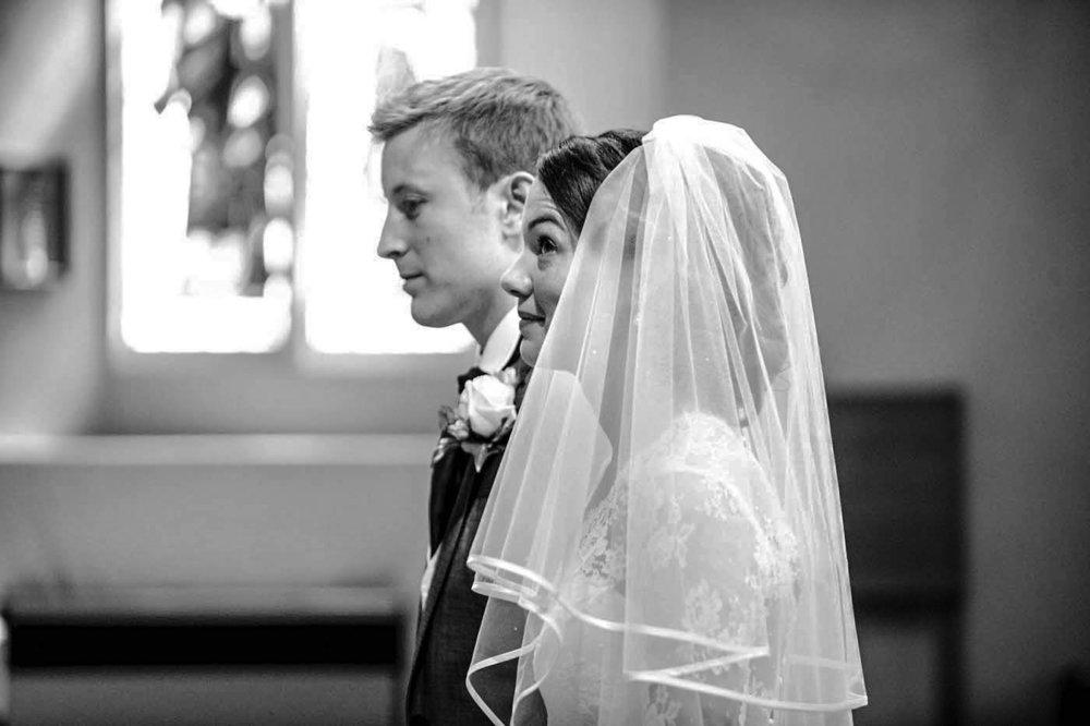 BRIDE-LOOKS-TO-HEAVENS-ST-MARYS-CHURCH-MERTON.jpg