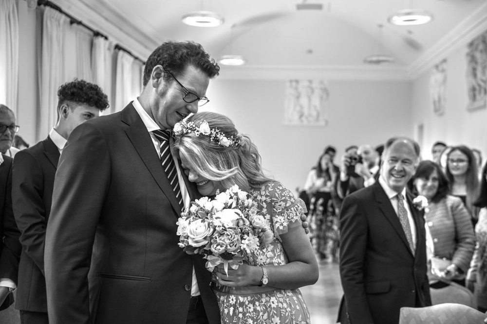 GROOM-EMBRACES-BRIDE-WEDDING-CEREMONY.jpg