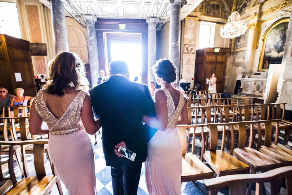 WEDDING-BESTMAN-BRIDESMAIDS-LEAVE-THE-CHURCH.jpg
