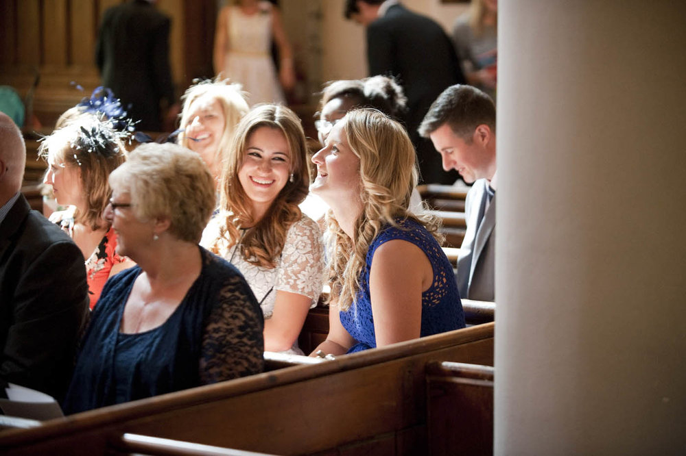 WEDDING-GUESTS-CHAT-IN-CHURCH.jpg