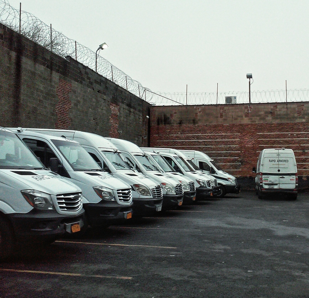 armored-trucks-in-parking-lot-wbc.jpg