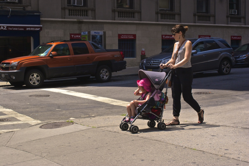 women-pushing-baby-nyc-street-timeframes-wbc.jpg