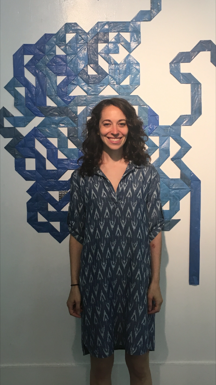 Shanti Grumbine in front of her installation at the 14th Street Y